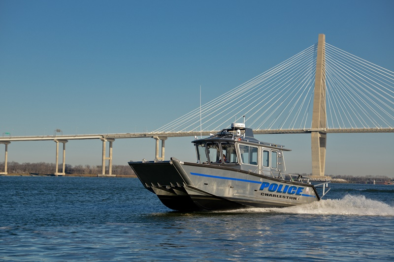 Police Boat Cruiser with a Bridge in the Background