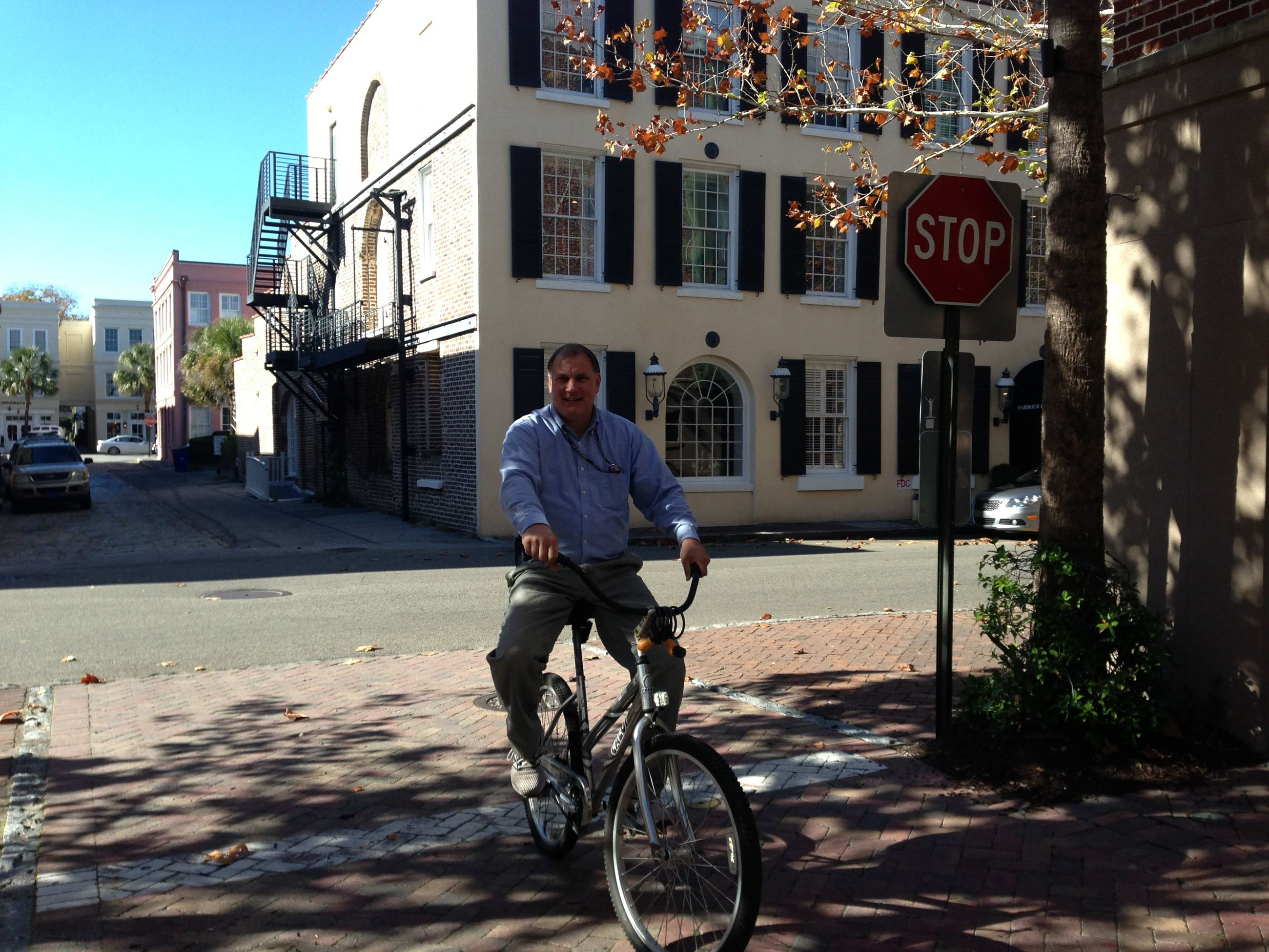 Eric riding a bike in downtown Charleston Opens in new window