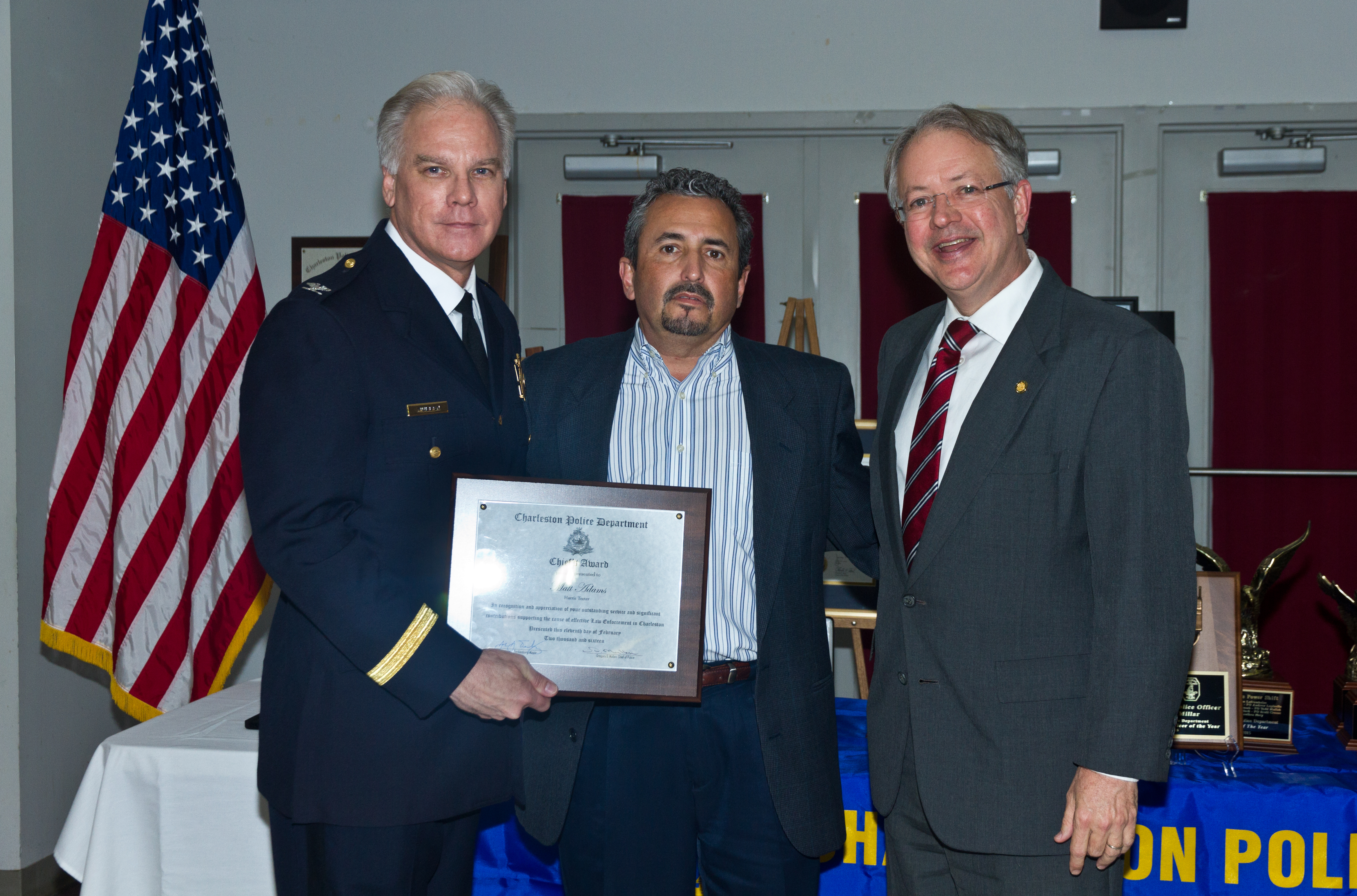 Receiving an award for support of the City of Charleston Police Department.